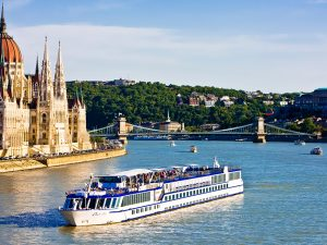Cruise ship passing the Parliament on the Danube, Budapest, Hungary